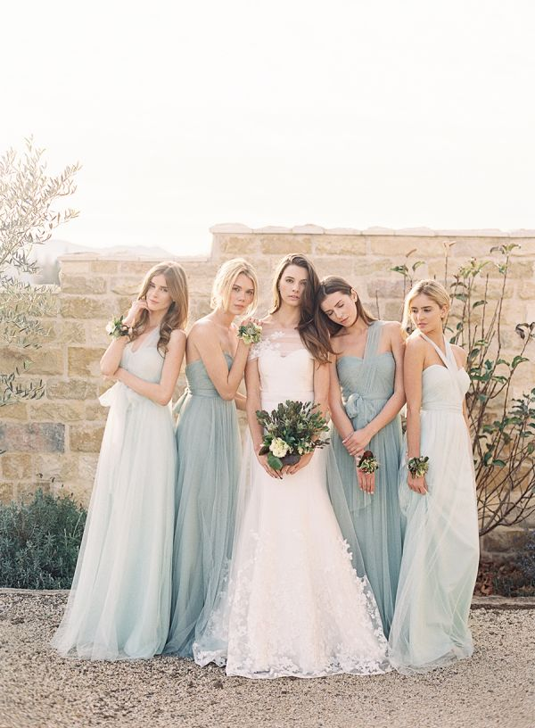 Bride in Steel Blue/Gray-Blue Dress with Bridesmaids in Lighter Power Blue Almost White/Ivory Dresses