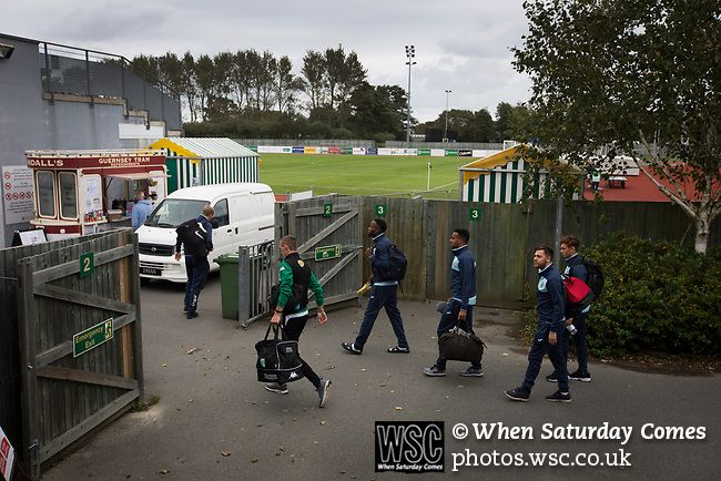 Guernsey 0 Corinthian-Casuals 1, 10/09/2017. Footes Lane, Isthmian League Division One. Rival players arriving at the ground as Guernsey take on Corinthian-Casuals in a Isthmian League Division One South match at Footes Lane. Formed in 2011, Guernsey FC are a community club located in St. Peter Port on the island of Guernsey and were promoted to the Isthmian League Division One South in 2013. The visitors from Kingston upon Thames won the fixture by 1-0, watched by a crowd of 614 spectators…