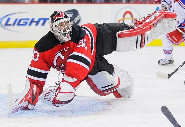 Devils goaltender Martin Brodeur dives to make a save