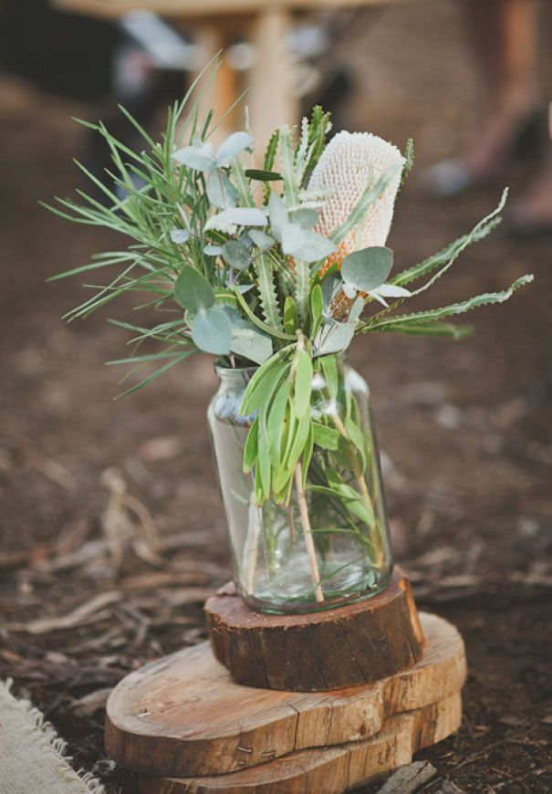 Flowers in jars. We will be looking to have simple, native flowers within jars around the reception to capture the rustic feel