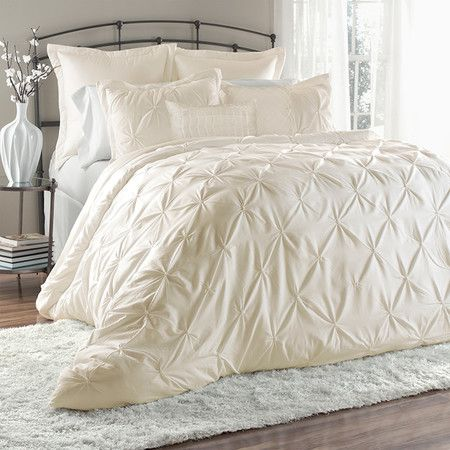 Refresh your master suite or guest room with this lovely comforter set, showcasing embroidered quilted detailing in ivory.  Product:...