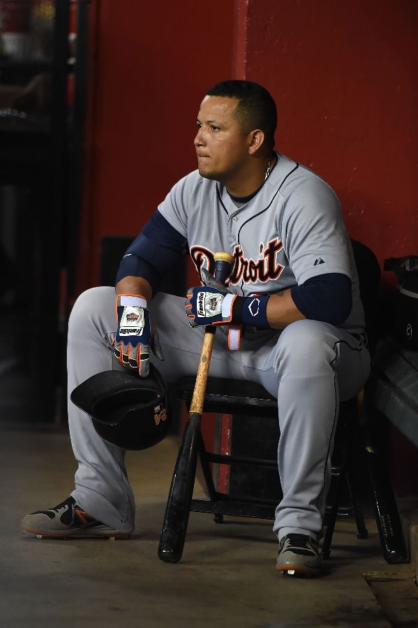 Miguel Cabrera sits in the corner of the dugout prior to his at bat, 07/21/2014