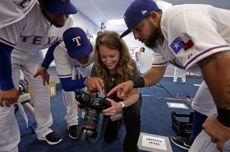 2017 spring training:     Sneak peek:    Texas Rangers players Elvis Andrus, left, Rougned Odor, right, and Robinson Chirinos look at photos taken by team photographer Kelly  Gavin during photo day at spring training practice Feb. 22 in Surprise, Ariz.