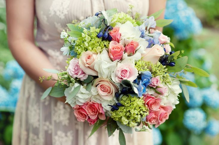 Bridal bouquet of pink roses, peach roses, and blue delphinium.  Love this bouquet - less green, more peach/blush, bigger flowers, more blue ??