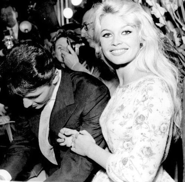 Brigitte Bardot and Sacha Distel sign autographs for fans, 1958