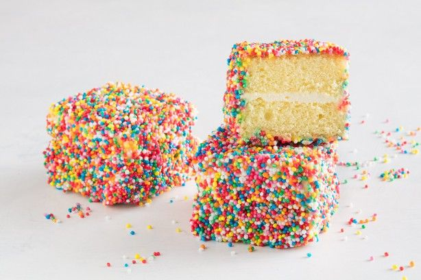 Combining two iconic Australian treats, these colourful fairy bread lamingtons will be a hit with kids and adults alike.