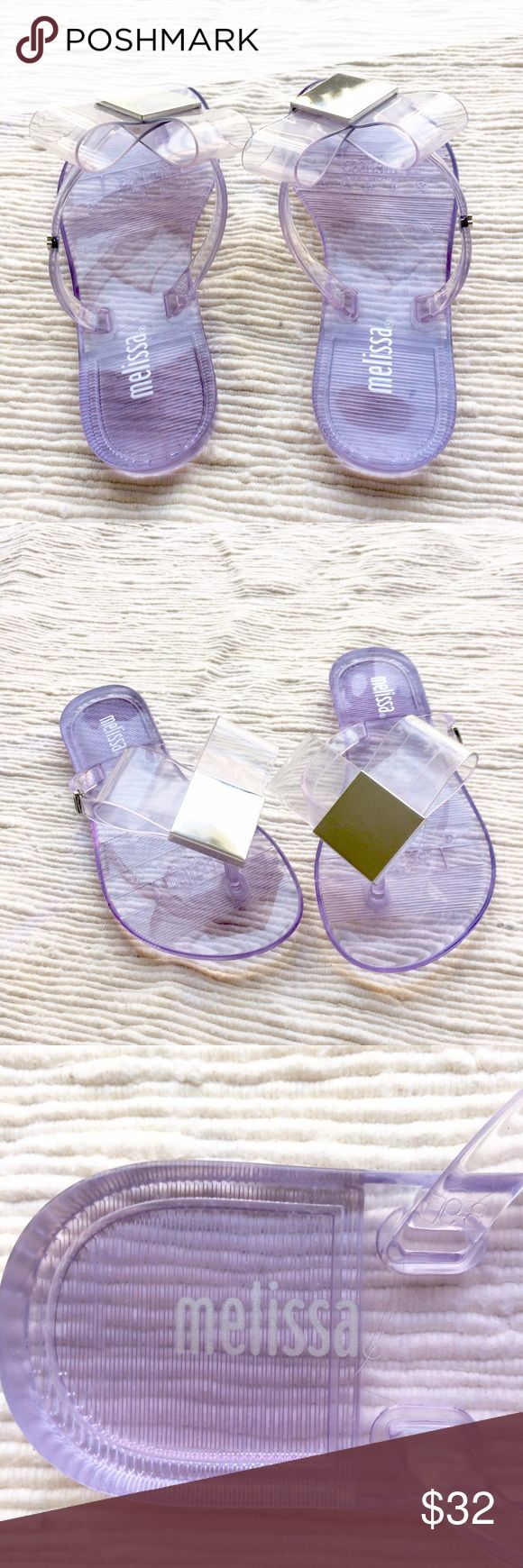 Mini Melissa flip flops New with no box or tags. Never worn however they do have a little scuff because they were never protected in a box. Clear with silver square buckle. Mini Melissa Shoes Sandals & Flip Flops