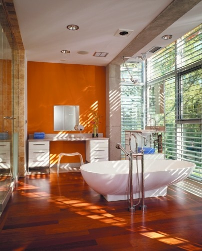 nice high ceilings with windows not sure about the orange wall I would change that to a more tranquil color