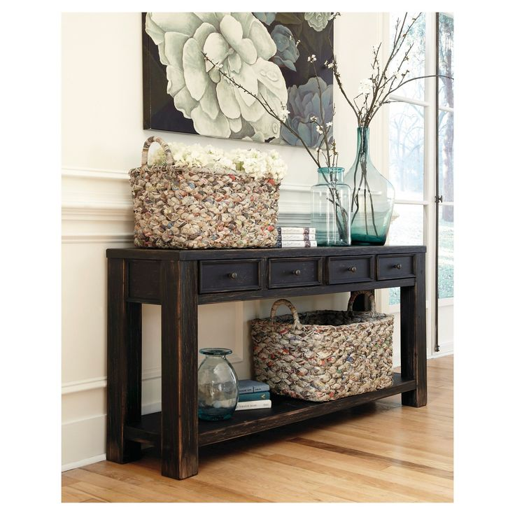•  Inspired by the sheer simplicity and weatherworn beauty of primitive furniture, this sofa table brings a relaxed sense of style into your space. Show off accent pieces on the bottom shelf, while concealing whatnots in the handy drawers.  Signature Design by Ashley is a registered trademark of Ashley Furniture Industries, Inc.