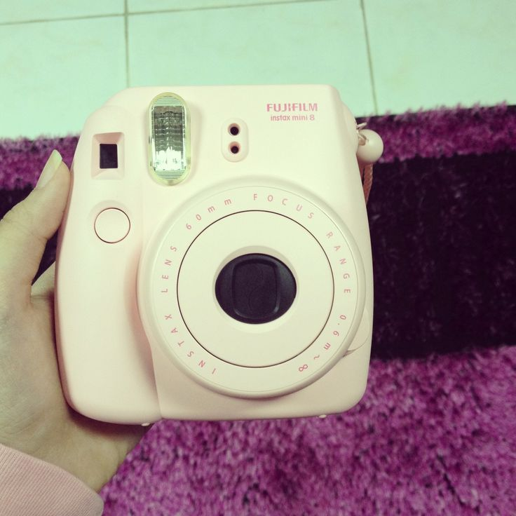 Ok, it's just like a Polaroid, but cheaper! Prints out pictures on the spot. Can you say Christmas gift? :D
