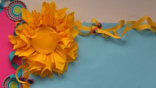 3D sun-- yellow napkins pinched in the middle and stapled in a circle with a yellow plate in the center. She explains how to make the curly border here: http://middleschoolocd.blogspot.com/search?q=bulletin+border