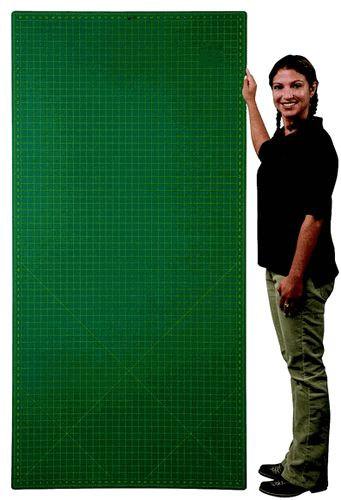 Magic Mat Self-Healing Large Cutting Mat (3x6)--anyone have any experience with this company?  I need a mat that will fit my table and the table is 72 inches by 36 inches so this would work.  I wish it had the curve markings on it though.  I need it to cut fabric on for my sewing projects.  Any other suggestions or is this the best one?