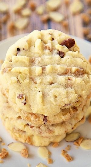 If you love almond flavors, then you are going to absolutely love these Triple Almond Cookies! They are packed full of tons of almond flavor. Almond extract, chopped almonds and almond toffee bits. They are dangerously delicious!