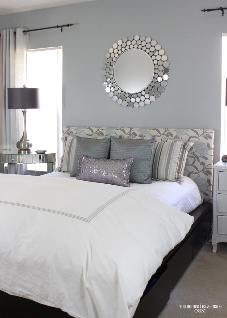 You'll love this modern and glam master bedroom renovation. With calming tones of gray and a sparkling mirror focal point, this room features wonderful interior design inspiration.