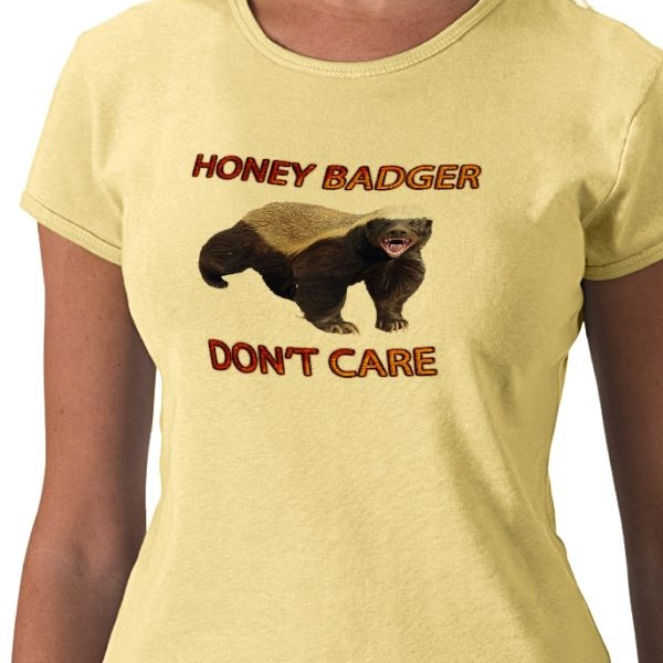 Honey Badger Don't Care T-Shirt. This classic baby doll is a best-selling ladies' top that will turn heads. Available at my store Just_Plain_Funny at Zazzle.