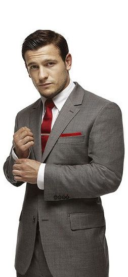 grey suit, white shirt and red tie