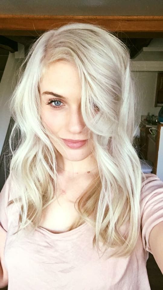 Cool platinum blonde by stylist Erin Elizabeth at Redhead Studio.  Balayage hair painting throughout to prelighten her natural level and toned with a level 9 pearle blonde.