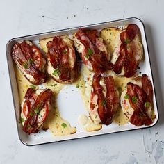 Get star chef Bobby Flay's recipe for these over-the-top hot turkey sandwiches with cheese sauce and bacon at Food & Wine.