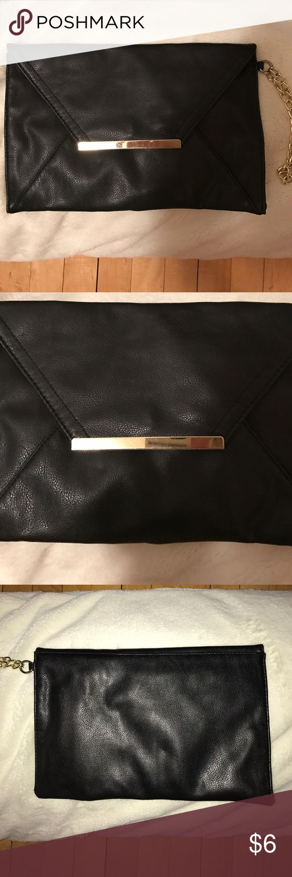 """Forever 21 Clutch Forever 21 black Clutch, gold details. Gold chain on side for wrist. Envelope style. 12"""" by 8"""" Forever 21 Bags Clutches & Wristlets"""