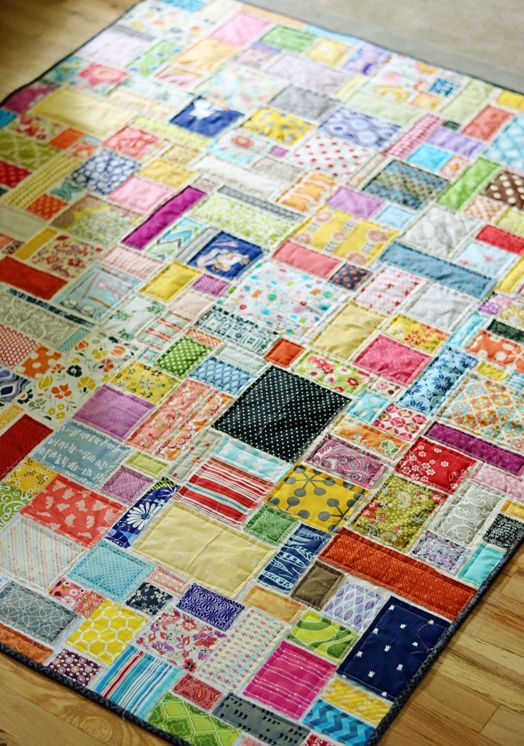 Scrappy quilt, placing scraps on top of 3 layers and quilting as you go.