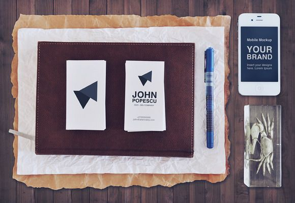 Branding Mockup Set  This is a carefully crafted set of 4 branding mockup photos. The photos are high resolution and were taken with a Nikon 90D and edited in Photoshop.  The mockups can be easily edited to display your own branding. Simply double click the smart object layer and paste your business card design, logo or text.  The pack features a couple of stationery items, business cards, an iPhone and a clean paper bag.