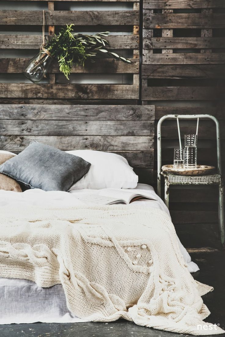 Rustic bedroom - love the cozy throw on the bed