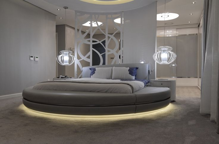 A modern take on a round bed, set in the centre of the room using a laser cut screen as a feature