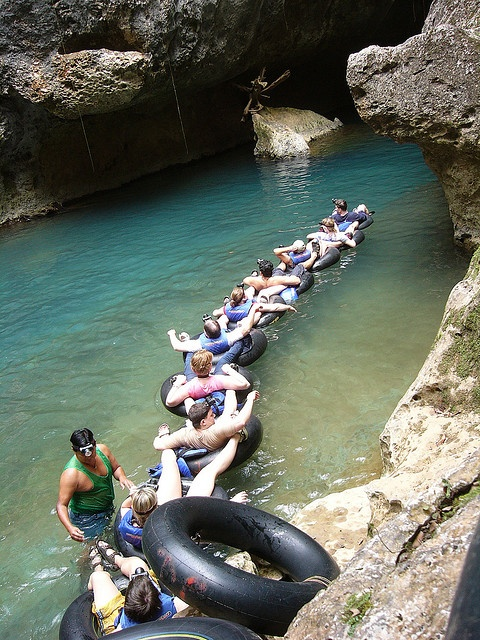 Cave tubing in Belize. Take the original and full 7 mile River of Caves tube float. Float a river through the jungle and underground into caves where the spirits of the ancient Maya echo through time. (V)
