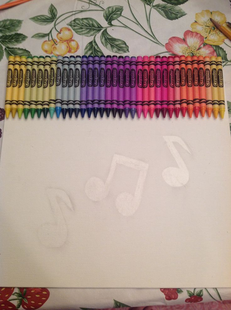 Before melting the crayons, used contact paper to make music notes. I later peeled them off