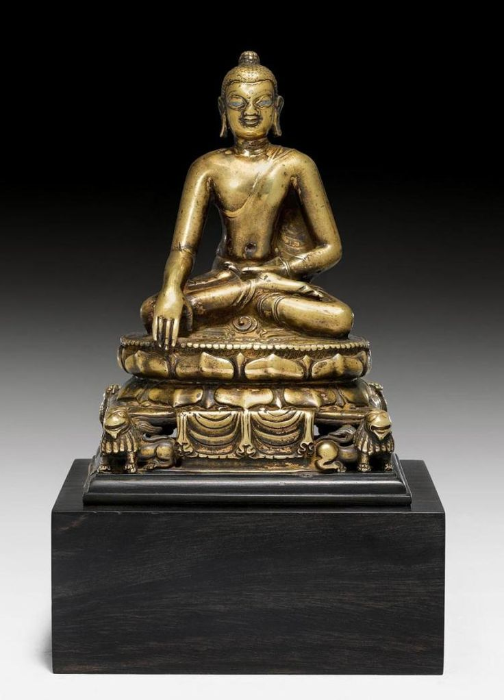 Description: A BRONZE FIGURE OF BUDDHA SHAKYAMUNI ON A LION THRONE. Northeastern India, Pala, 8th/9th c. Height 16.5 cm. Silver and copper inlays. This Buddha could possibly originate from the Nalanda Monastery in Bihar in North India. Nalanda was a famous centre for Buddhist studies between the 8th and 12th centuries. Scholars from many countries outside India studied sometimes for many years Vajrayana Buddhism at the Nalanda University. On the way back to their home countries they usually…