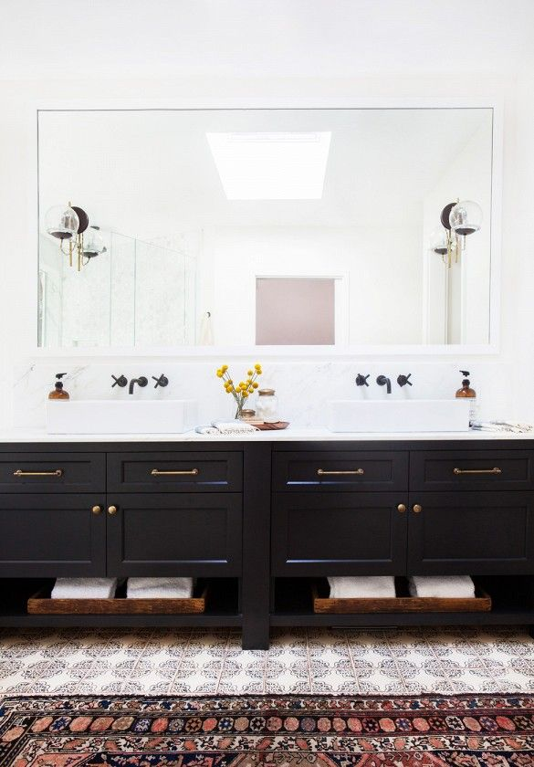 Master bathroom with black vanity in a California eclectic home. Photo: Tessa Neustadt