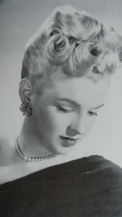 Marilyn modeling the Latest Hairstyles of 1947 for Twentieth Century Fox.