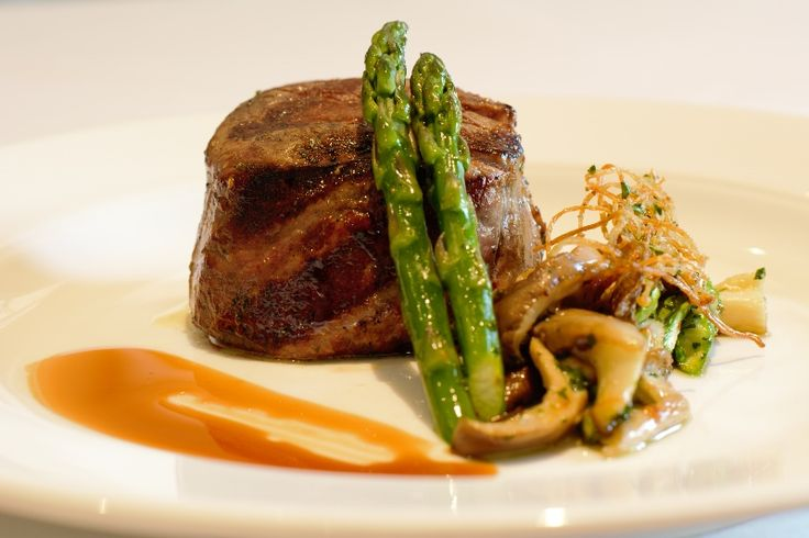2 Year Old Grain Feed Black Angus  Char-Grilled Tenderloin of Beef                     Topped with truffle butter and accompanied with a green asparagus and mushroom salad  and a red with jus