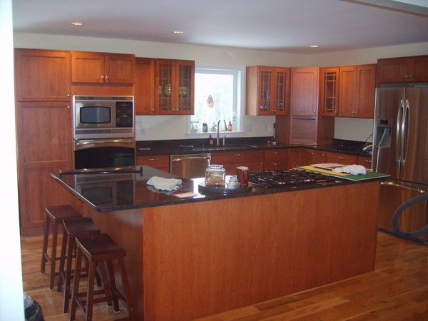 black countertops with cherry cabinets kithen w cherry cabinets and black granite counter tops