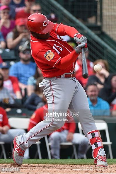 News Photo : Dilson Herrera of the Cincinnati Reds hits a RBI...