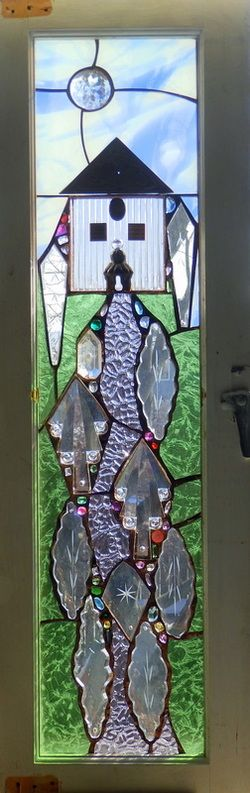 Home -   Luxfer tile, copper roof that is a desk pad edge, antique chandelier prisms    and glass gems.  by Alison Fox, Artist