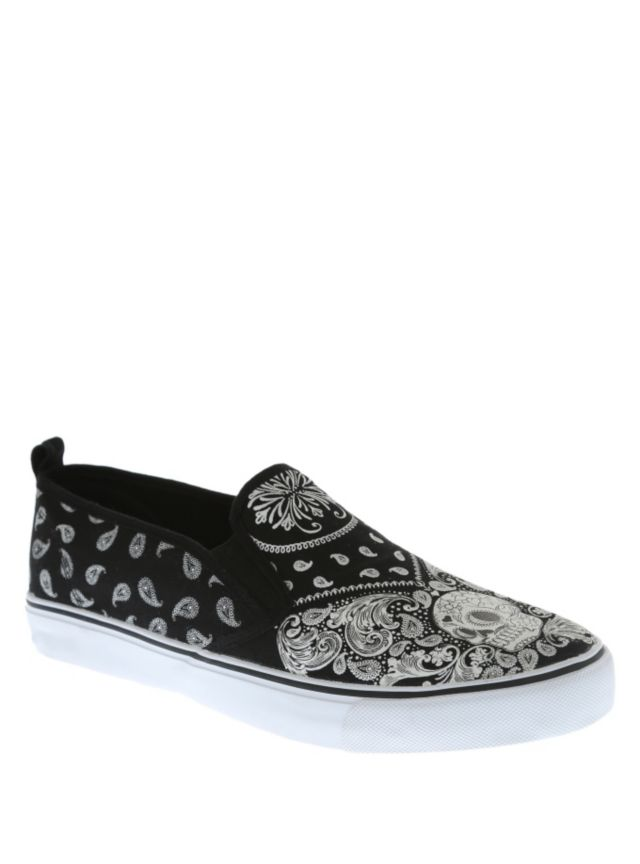 Black slip-on shoes with a white paisley bandana skull print.