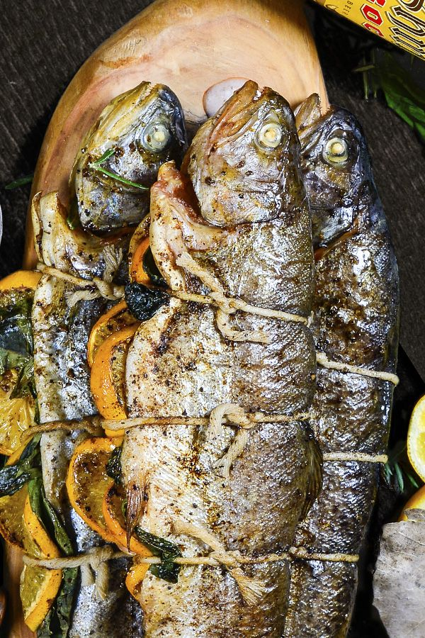 This grilled trout recipe will make you look like a grillin' villain. Stuff the herbs, spices, and lemons between 2 trout filets, tie them together, and give the bundle a quick 5 minute grill on each side, it comes out fresh and flavorful.