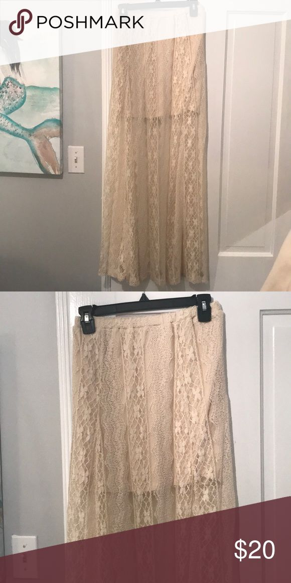 Floor length lacy skirt Only worn once! Floor length lacy skirt. There is a short skirt lining underneath the lacy as seen in picture 2. This is a great skirt for the beach and summer! No trades but offers are welcomed! Billabong Skirts Mini
