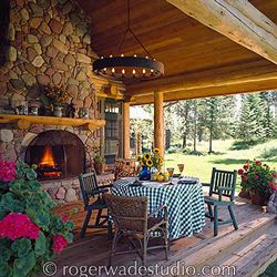 amazing log home front porch with bistro table