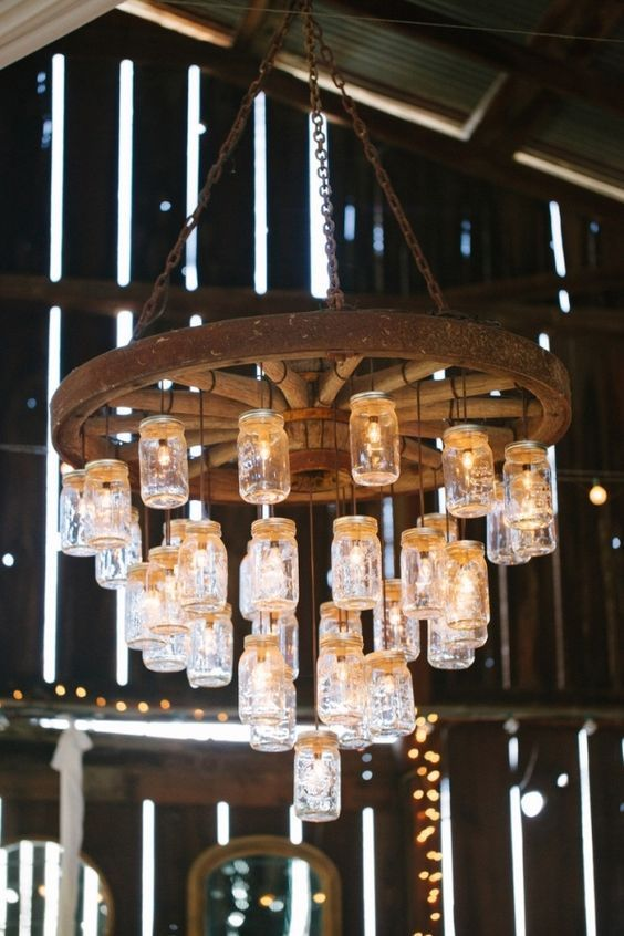 Mason Jar Wagon Wheel Wedding Chandelier for Rustic Barn Weddings / http://www.deerpearlflowers.com/rustic-country-wagon-wheel-wedding-ideas/