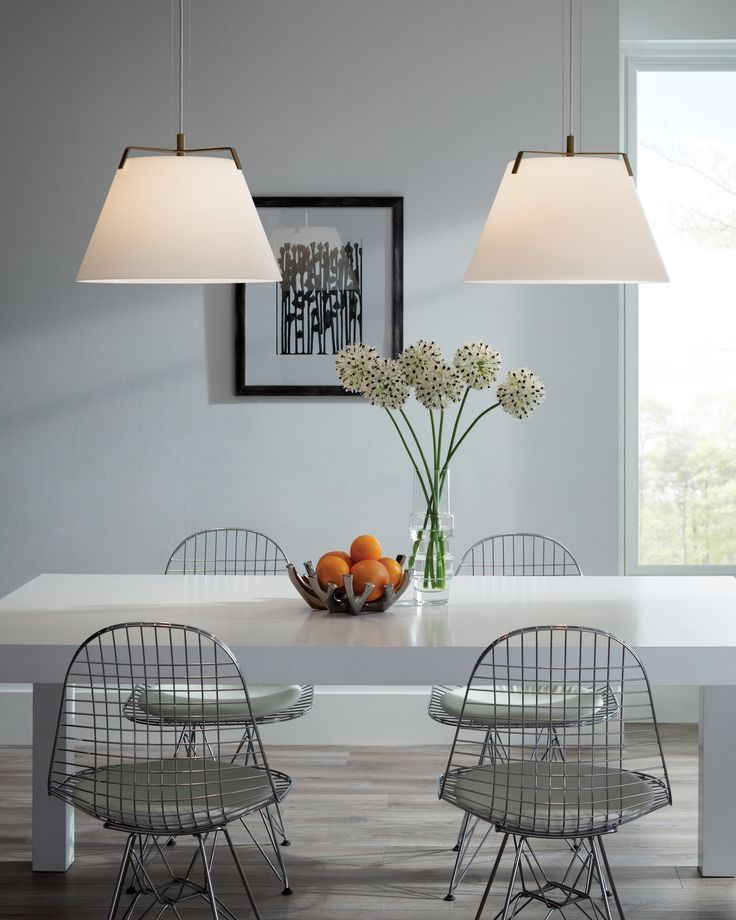 The devin pendant light from tech lighting has a large hand blown frosted glass