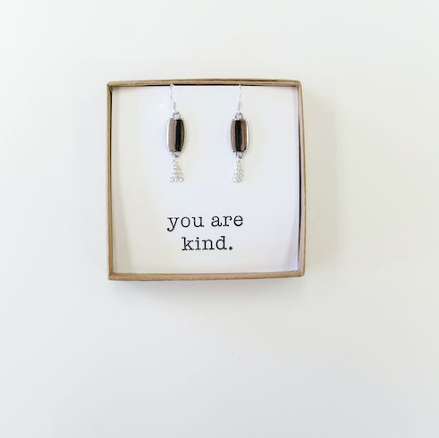 Our Silver Lining Earrings pair with our Silver Lining Long Necklace. They feature sterling ear hooks, silver rectangle drops with silver chain fringe dangles. The compliment in the box can be personalized at checkout.