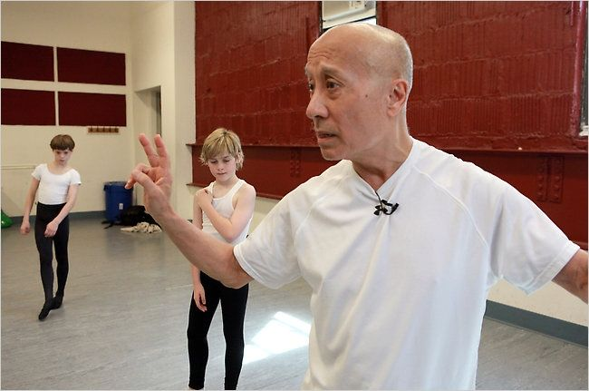 """Don't rely on the barre: Finis Jhung, once a principal with Harkness Ballet, is 75; here, teaching for the gruelling show """"Billy Elliot."""" """"Mr. Jhung sets little store by barre work and the attendant grabbing for support. 'Always be in balance, always in control,' he urged his charges — emphasizing the spring action of the bent knee in plié for powerful jumps, turns and combinations. 'I'm not interested in textbook figures,' Mr. Jhung said. 'I'm interested in the mechanics of movement.'"""""""