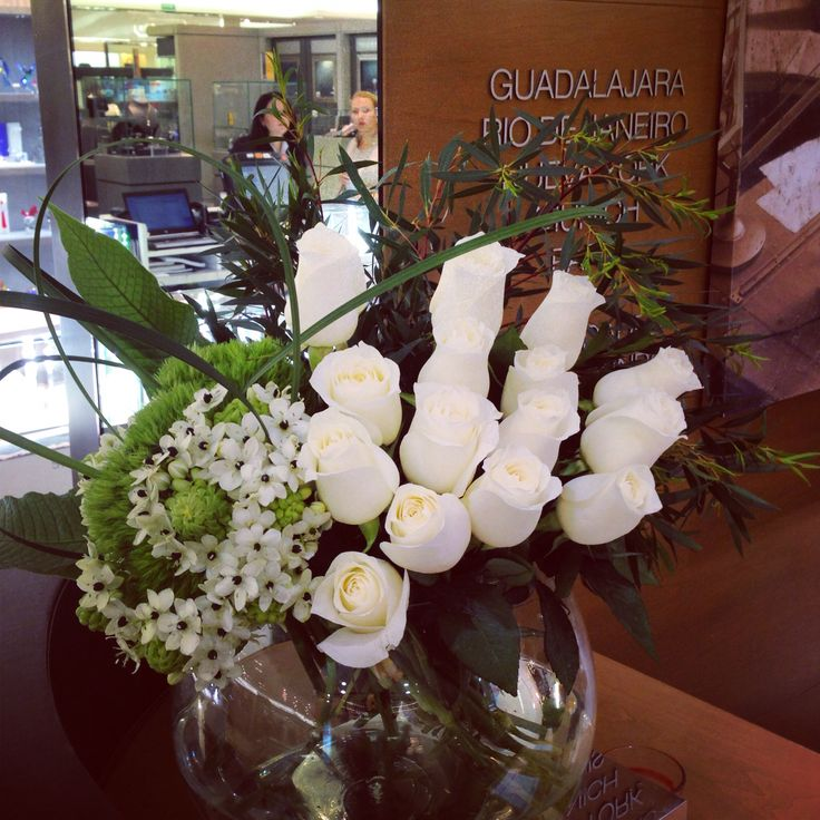 White roses and ornitogallum flower arrangement