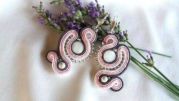 Earrings made in soutache tehnique.