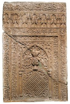 A CARVED STONE MIHRAB PANEL