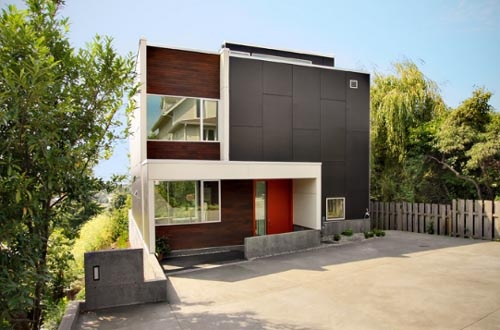 nice mix of cladding and ways to break it up The Back Yard House by Shed