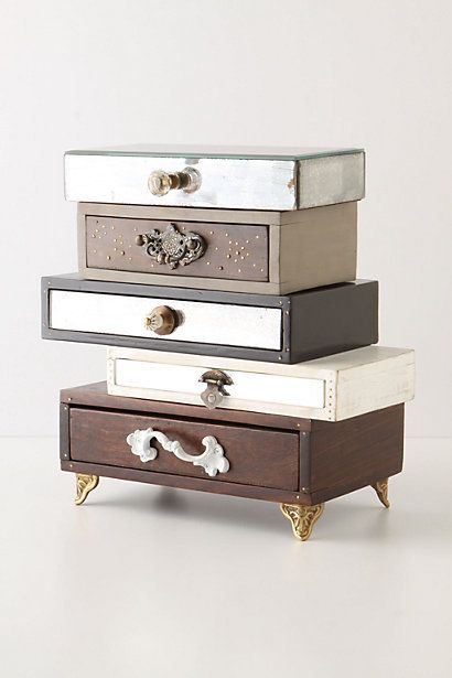 Topsy-Turvy Jewelry Box.  I really like the eclectic feeling the oddly stacked drawers give off.  I think this could be a cool DIY project too if I did some thrifting!