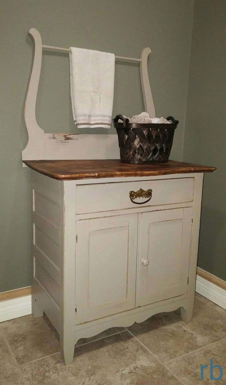 Wash stand in grey. Distressed and waxed. Great in the laundry room!